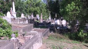 Sloping Cemetery. This cemetery was the first official cemetery in the city of Brisbane Australia, with the first grave dating to 1871.  The cemetery is still in stock footage