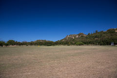 The sloping field at the foot of the mountain Royalty Free Stock Photos