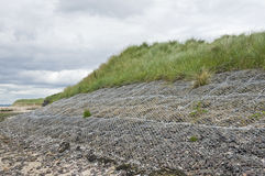 Sloping gabions. Counter erosion of sand dunes at Eden estuary, St. Andrews, Scotland; the area adjoins the famous Old Course. Gabions act as buffers against Stock Image