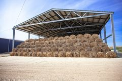 Sloping hay under a canopy. hay store stock photography