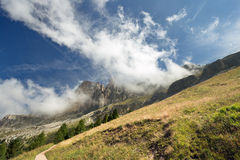 Sloping meadow in the Dolomites Royalty Free Stock Photos
