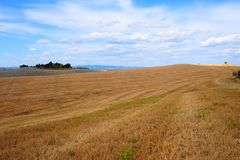 Sloping Meadows. Farmhouse Surrounded By Sloping Meadows Of Tuscany Stock Photos