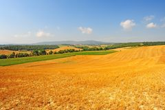 Sloping Meadows. Farmhouse Surrounded By Sloping Meadows Of Tuscany Royalty Free Stock Images