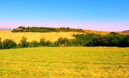 Sloping Meadows. Farmhouse Surrounded By Sloping Meadows Of Tuscany Royalty Free Stock Photos