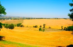 Sloping Meadows. Farmhouse Surrounded By Sloping Meadows Of Tuscany Royalty Free Stock Photo