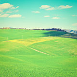Sloping Meadows. Farmhouse and Green Sloping Meadows of Tuscany, Instagram Effect Stock Image