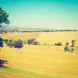 Sloping Meadows. Farmhouse Surrounded by Sloping Meadows of Tuscany, Instagram Effect Royalty Free Stock Photos