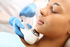 Sloping oval of the face  Ultrasound beauty treatment Stock Photography