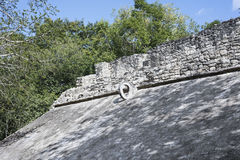 The sloping side of a Ball Court with stone ring at top for goal Stock Images