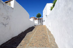 Sloping street. One of old streets in Burguillos del Cerro, a municipality in the province of Badajoz, Extremadura, Spain. It has a population of about 3,000 royalty free stock photo