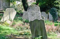 Sloping tombstones in ancient  graveyard Royalty Free Stock Photos