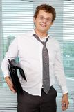 Sloppy businessman. With briefcase looking at camera Royalty Free Stock Photo