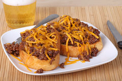 Sloppy Joe. Sandwich on texas toast covered with shredded cheese and a drink Stock Images