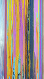 Sloppy Paint Streaks. Colorful sloppy paint streaks on side of building. Vertical Royalty Free Stock Image