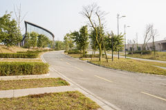 Slopy asphalt road between modern buildings in sunny spring afte. Rnoon,Chengdu,China Stock Photos