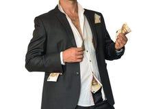Slordige mens in een kostuum en geld in zakken Royalty-vrije Stock Afbeeldingen