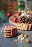Sloseup on almond cookies with cinnamon sticks, clovers, almonds. And Christmas tree twigs on rustic wooden background Royalty Free Stock Photography