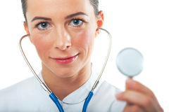 Sloseup portrait of woman doctor showing her stethoscope. Attractive smiling female doctor showing her stethoscope. Focus on face of woman doctor Stock Image