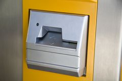 Slot. Card slot of a moneychanger Stock Photography