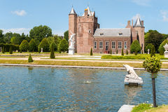 Slot assumburg castle. Dutch castle slot assumburg heemkerk with design garden Royalty Free Stock Photography