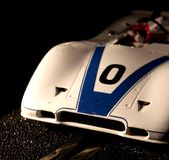 Slot car. Small slot car that is on the track taking a curve Royalty Free Stock Photos