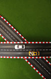 Slot Car 4. Slot cars on crossing track Royalty Free Stock Photo