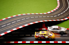 Slot Car 6. Two slot cars on crossing track Royalty Free Stock Photo