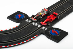 Slot car racing track with formula one cars Royalty Free Stock Images