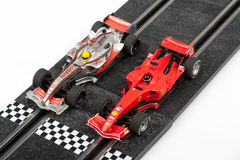 Slot car racing track with formula one cars Royalty Free Stock Photos