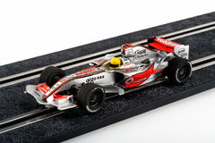 Slot car racing track with silver formula one car Royalty Free Stock Photos