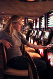 Slot casino. Beautiful blonde girl playing in slot casino Stock Photography