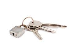 Slot en drie sleutels stock afbeelding