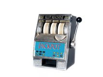 Slot machine. Small slot machine with spinning wheels Royalty Free Stock Image