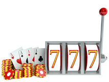 Slot Machine and chips with playing cards Stock Photos