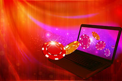 Slot machine coins going out from a laptop screen Royalty Free Stock Photo
