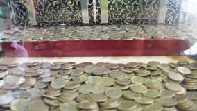 Slot Machine with Coins. On the Street. Full HD 1920 x 1080, 29,97fps stock footage
