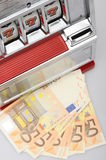 Slot machine and fifty euro banknotes Stock Images