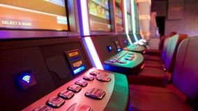 Slot machine games in adult entertainment room at casino stock video