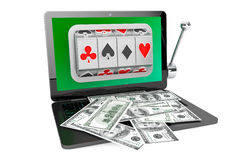 Slot machine inside laptop with dollars Royalty Free Stock Photography