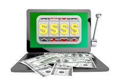 Slot machine inside laptop with dollars Royalty Free Stock Images