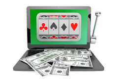 Slot machine inside laptop with dollars Stock Images
