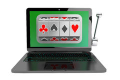 Slot machine inside laptop Stock Photography