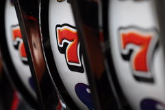 Slot machine and jackpot. Close up of three seven jackpot on a casino slot machine Stock Images