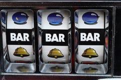Slot machine and jackpot. Close up of three seven jackpot on a casino slot machine Stock Photos