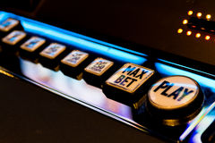Slot Machine Play. Electronic slot machine buttons offering gambling choices Royalty Free Stock Photo