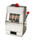 Slot Machine. Small Slot Machine with Sevens Jackpot Isolated on White Background royalty free stock photo
