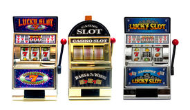 Slot machine. Three vintage toy slot machines with gold money royalty free stock images