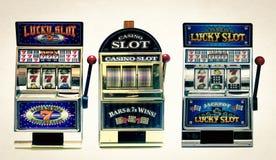 Slot machine. Three vintage toy slot machines with gold money stock photos