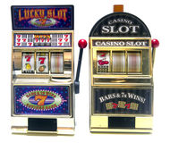 Slot machine. Two vintage toy slot machines with gold money stock photography