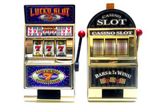 Slot machine. Two vintage toy slot machines with gold money royalty free stock photos